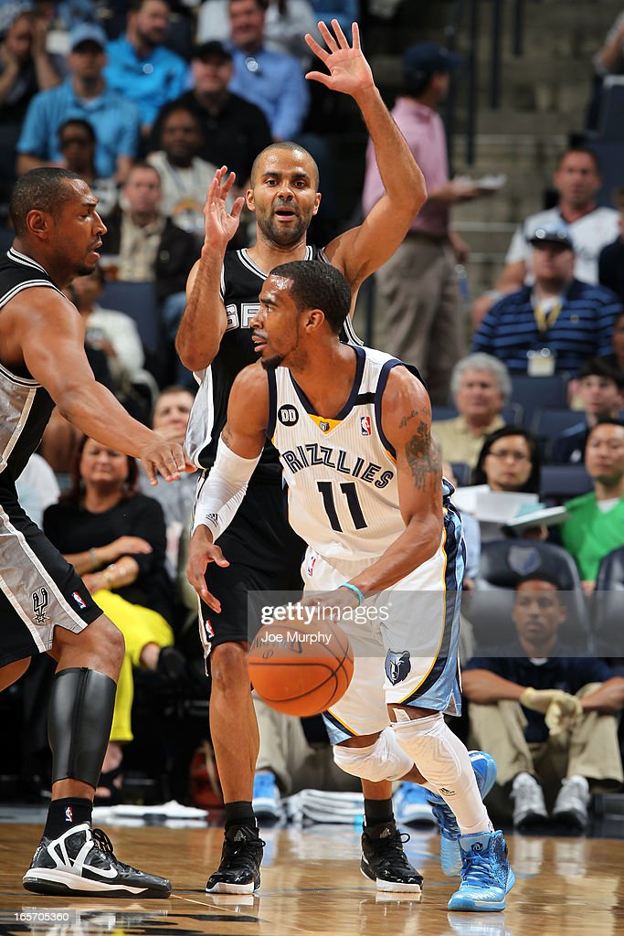 Mike Conley #11 of the Memphis Grizzlies looks to pass the ball against the San Antonio Spurs on April 1, 2013 at FedExForum in Memphis, Tennessee.