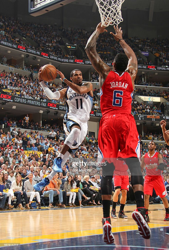 Mike Conley #11 of the Memphis Grizzlies looks to pass the ball around DeAndre Jordan #6 of the Los Angeles Clippers in Game Three of the Western Conference Quarterfinals during the 2013 NBA Playoffs on April 25, 2013 at FedExForum in Memphis, Tennessee.