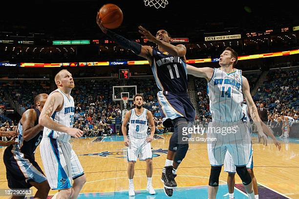Mike Conley of the Memphis Grizzlies makes a layup over Jason Smith of the New Orleans Hornets at New Orleans Arena on January 18 2012 in New Orleans...
