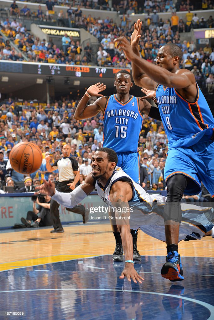 Mike Conley #11 of the Memphis Grizzlies makes a pass against the Oklahoma City Thunder in Game Four of the Western Conference Quarterfinals during the 2014 NBA Playoffs on April 26, 2014 at FedExForum in Memphis, Tennessee.