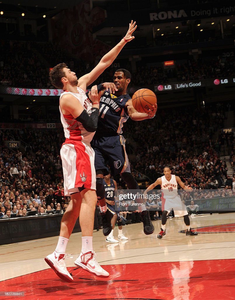Mike Conley #11 of the Memphis Grizzlies passes the ball against <a gi-track='captionPersonalityLinkClicked' href=/galleries/search?phrase=Andrea+Bargnani&family=editorial&specificpeople=533014 ng-click='$event.stopPropagation()'>Andrea Bargnani</a> #7 of the Toronto Raptors on February 20, 2013 at the Air Canada Centre in Toronto, Ontario, Canada.