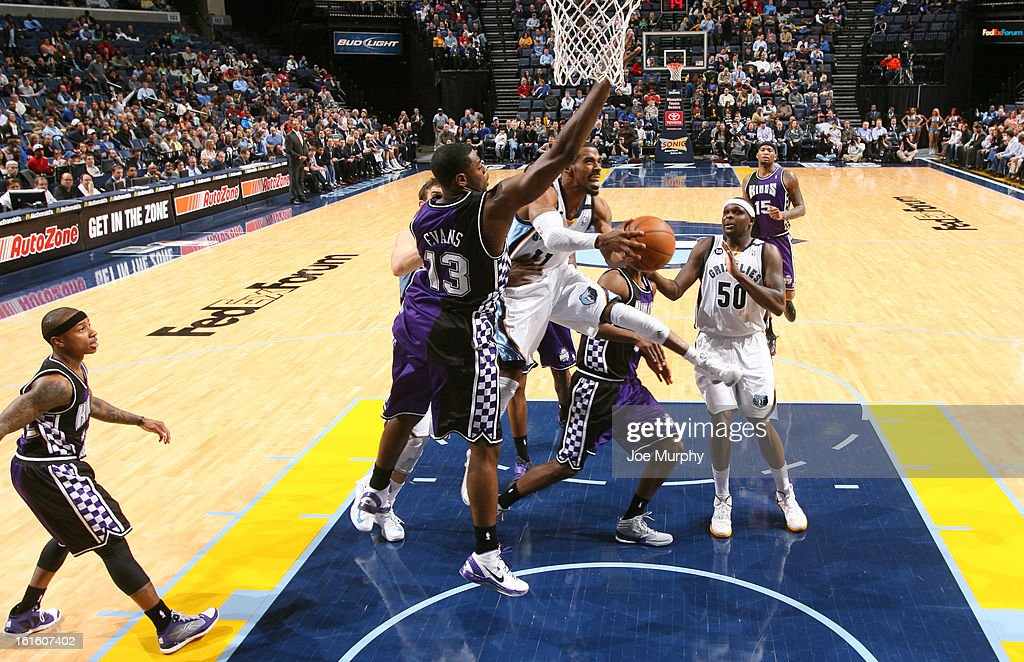Mike Conley #11 of the Memphis Grizzlies passes the ball against <a gi-track='captionPersonalityLinkClicked' href=/galleries/search?phrase=Tyreke+Evans&family=editorial&specificpeople=4851025 ng-click='$event.stopPropagation()'>Tyreke Evans</a> #13 of the Sacramento Kings on February 12, 2013 at FedExForum in Memphis, Tennessee.