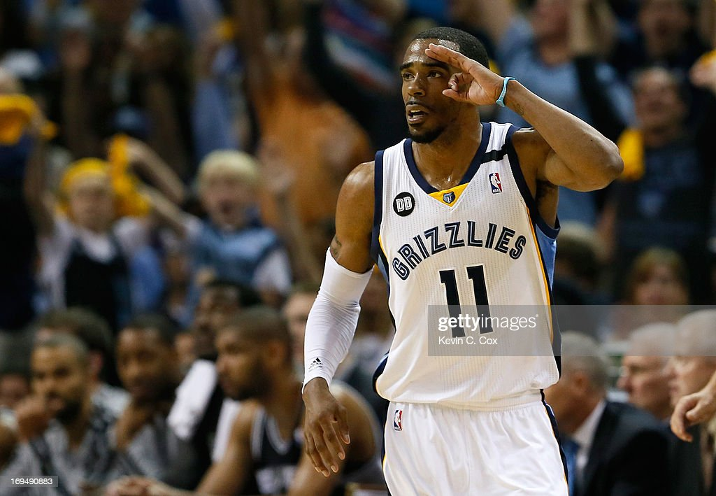 Mike Conley #11 of the Memphis Grizzlies reacts after making a three-pointer in the first half while taking on the San Antonio Spurs during Game Three of the Western Conference Finals of the 2013 NBA Playoffs at the FedExForum on May 25, 2013 in Memphis, Tennessee.