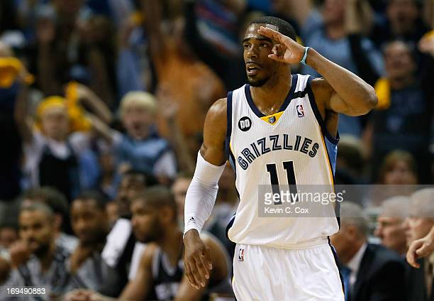 Mike Conley of the Memphis Grizzlies reacts after making a threepointer in the first half while taking on the San Antonio Spurs during Game Three of...