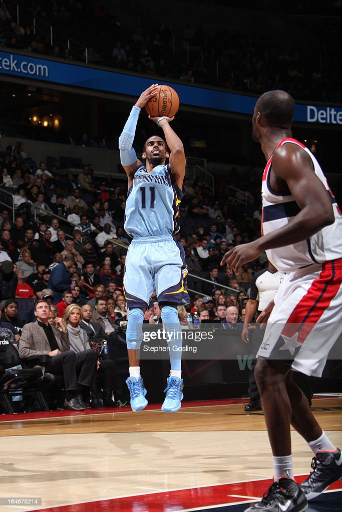Mike Conley #11 of the Memphis Grizzlies shoots a jumper against the Washington Wizards at the Verizon Center on March 25, 2013 in Washington, DC.