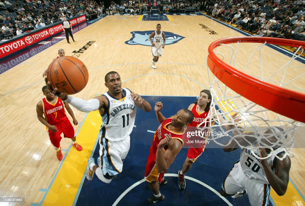 Mike Conley #11 of the Memphis Grizzlies shoots a layup against <a gi-track='captionPersonalityLinkClicked' href=/galleries/search?phrase=Chuck+Hayes&family=editorial&specificpeople=206129 ng-click='$event.stopPropagation()'>Chuck Hayes</a> #44 of the Houston Rockets on January 21, 2011 at FedExForum in Memphis, Tennessee.