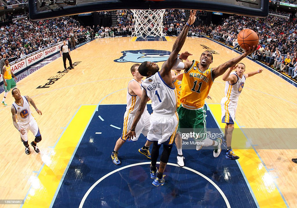 Mike Conley #11 of the Memphis Grizzlies shoots a layup against <a gi-track='captionPersonalityLinkClicked' href=/galleries/search?phrase=Dorell+Wright&family=editorial&specificpeople=211344 ng-click='$event.stopPropagation()'>Dorell Wright</a> #1 of the Golden State Warriors on February 18, 2012 at FedExForum in Memphis, Tennessee.