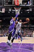 Mike Conley of the Memphis Grizzlies shoots a layup against Jason Thompson of the Sacramento Kings on February 25 2015 at Sleep Train Arena in...