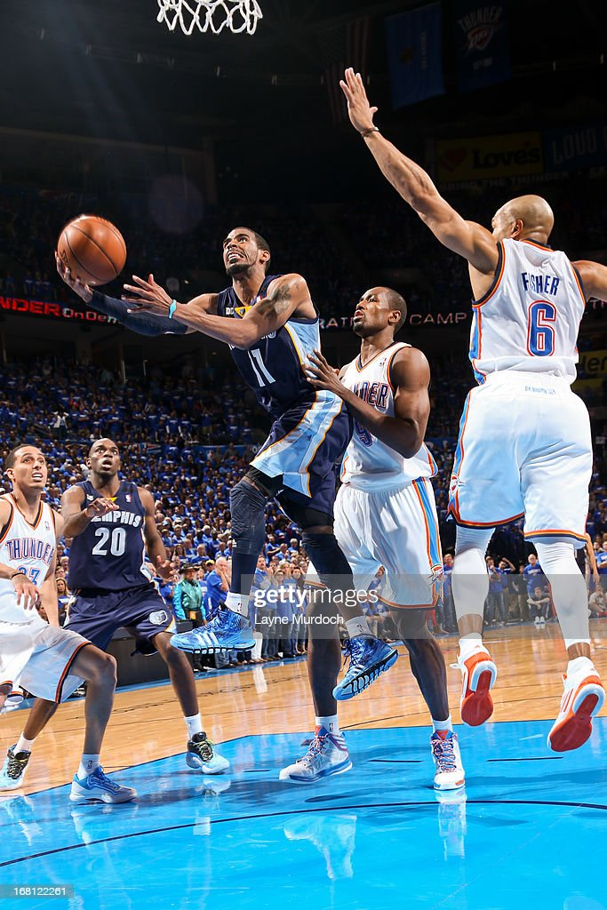 Mike Conley #11 of the Memphis Grizzlies shoots a layup against Serge Ibaka #9 and Derek Fisher #6 of the Oklahoma City Thunder in Game One of the Western Conference Semifinals during the 2013 NBA Playoffs on May 5, 2013 at the Chesapeake Energy Arena in Oklahoma City, Oklahoma.