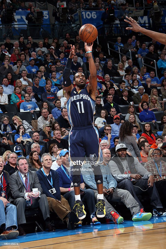 Mike Conley #11 of the Memphis Grizzlies shoots a wide-open shot against the Oklahoma City Thunder during an NBA game on January 31, 2013 at the Chesapeake Energy Arena in Oklahoma City, Oklahoma.