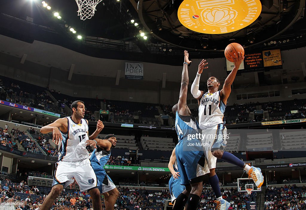 Mike Conley #11 of the Memphis Grizzlies shoots against <a gi-track='captionPersonalityLinkClicked' href=/galleries/search?phrase=Anthony+Tolliver&family=editorial&specificpeople=4195496 ng-click='$event.stopPropagation()'>Anthony Tolliver</a> #44 of the Minnesota Timberwolves on October 30, 2010 at the FedExForum in Memphis, Tennessee.
