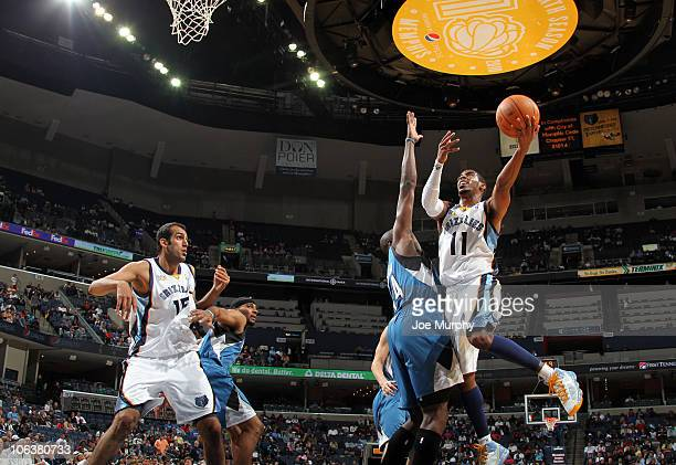 Mike Conley of the Memphis Grizzlies shoots against Anthony Tolliver of the Minnesota Timberwolves on October 30 2010 at the FedExForum in Memphis...