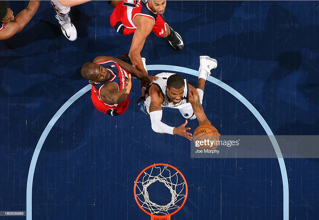 Mike Conley #11 of the Memphis Grizzlies shoots against <a gi-track='captionPersonalityLinkClicked' href=/galleries/search?phrase=Emeka+Okafor&family=editorial&specificpeople=201739 ng-click='$event.stopPropagation()'>Emeka Okafor</a> #50 of the Washington Wizards on February 1, 2013 at FedExForum in Memphis, Tennessee.