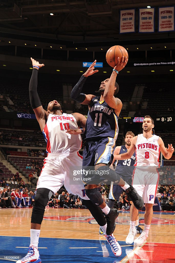 Mike Conley #11 of the Memphis Grizzlies shoots against <a gi-track='captionPersonalityLinkClicked' href=/galleries/search?phrase=Greg+Monroe&family=editorial&specificpeople=5042440 ng-click='$event.stopPropagation()'>Greg Monroe</a> #10 of the Detroit Pistons on February 19, 2013 at The Palace of Auburn Hills in Auburn Hills, Michigan.