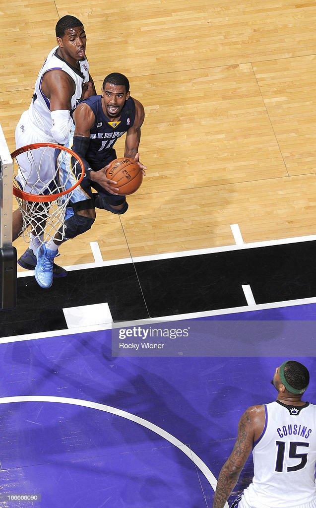 Mike Conley #11 of the Memphis Grizzlies shoots against Jason Thompson #34 of the Sacramento Kings on April 7, 2013 at Sleep Train Arena in Sacramento, California.