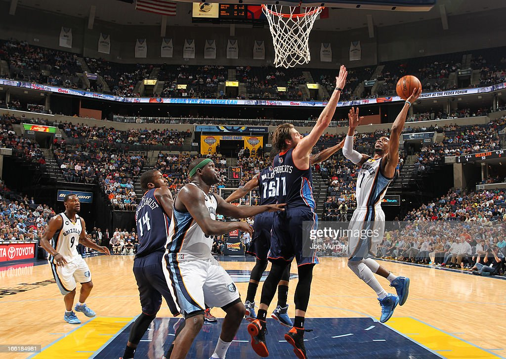 Mike Conley #11 of the Memphis Grizzlies shoots against <a gi-track='captionPersonalityLinkClicked' href=/galleries/search?phrase=Josh+McRoberts+-+Basketball+Player&family=editorial&specificpeople=732530 ng-click='$event.stopPropagation()'>Josh McRoberts</a> #11 of the Charlotte Bobcats on April 9, 2013 at FedExForum in Memphis, Tennessee.