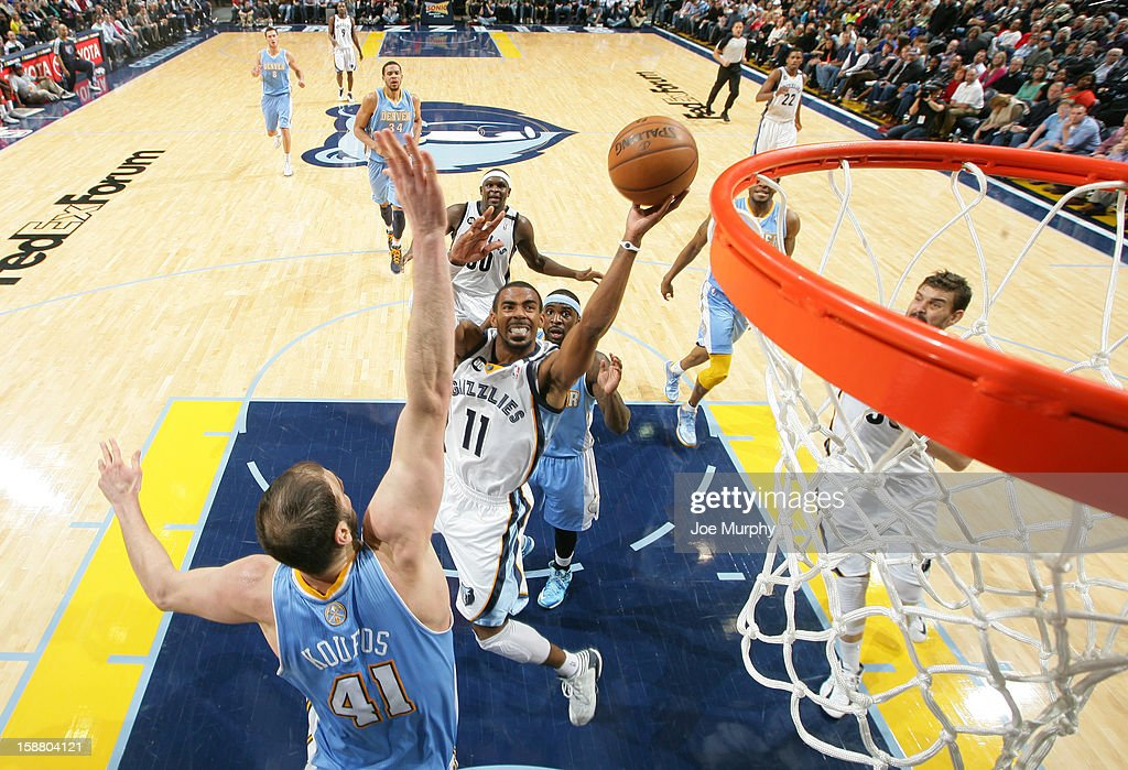 Mike Conley #11 of the Memphis Grizzlies shoots against Kosta Koufos #41 of the Denver Nuggets on December 29, 2012 at FedExForum in Memphis, Tennessee.