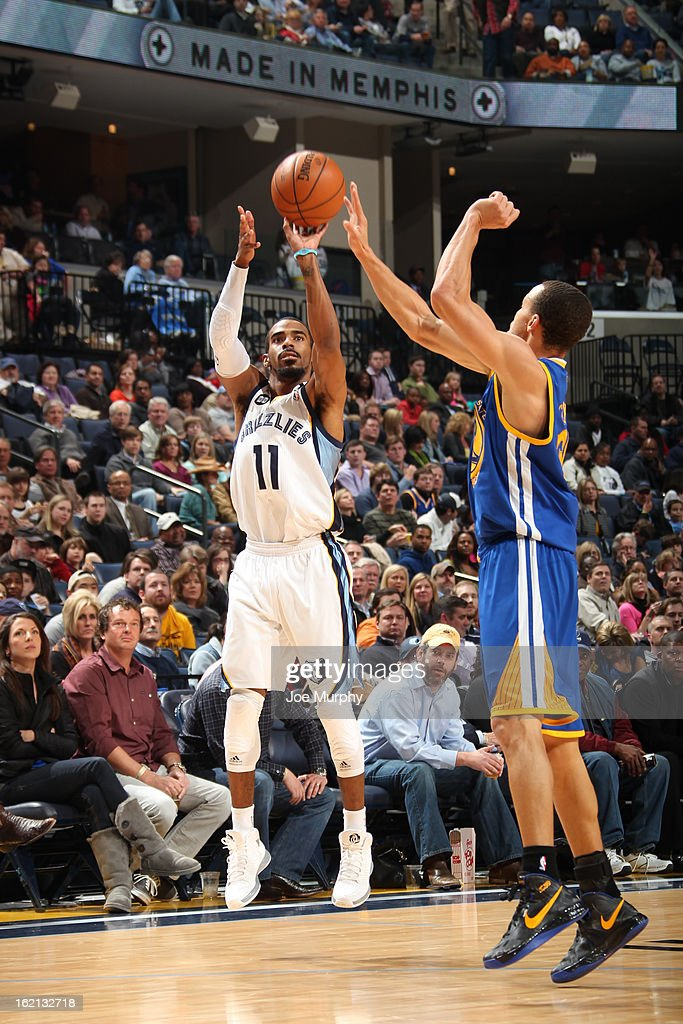Mike Conley #11 of the Memphis Grizzlies shoots against the Golden State Warriors on February 8, 2013 at FedExForum in Memphis, Tennessee.