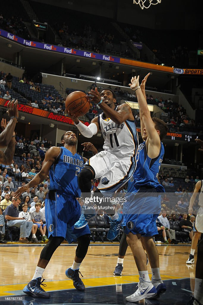 Mike Conley #11 of the Memphis Grizzlies shoots against <a gi-track='captionPersonalityLinkClicked' href=/galleries/search?phrase=Wayne+Ellington&family=editorial&specificpeople=2351537 ng-click='$event.stopPropagation()'>Wayne Ellington</a> #21 of the Dallas Mavericks during a game on October 9, 2013 at FedExForum in Memphis, Tennessee.