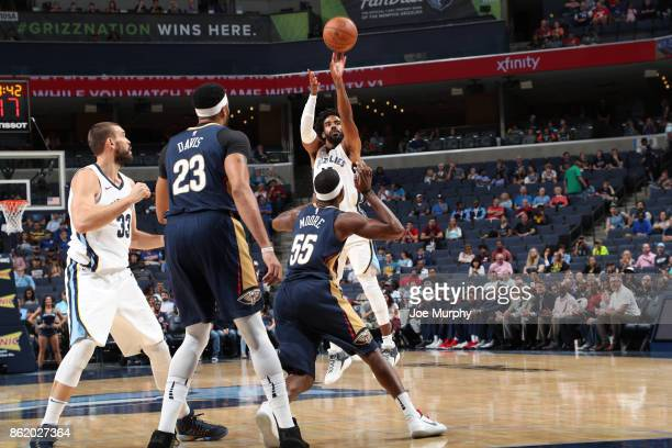 Mike Conley of the Memphis Grizzlies shoots the ball against the New Orleans Pelicans during a preseason game on October 13 2017 at FedExForum in...