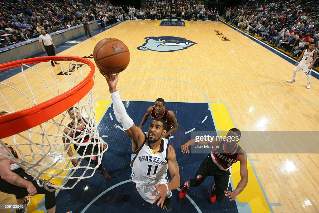 Mike Conley #11 of the Memphis Grizzlies shoots the ball against the Portland Trail Blazers on February 8, 2016 at FedExForum in Memphis, Tennessee.