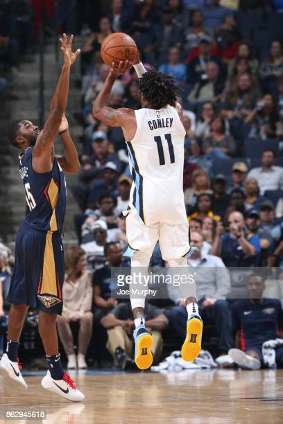 Mike Conley of the Memphis Grizzlies shoots the ball during the 201718 regular season game against the New Orleans Pelicans on October 18 2017 at...