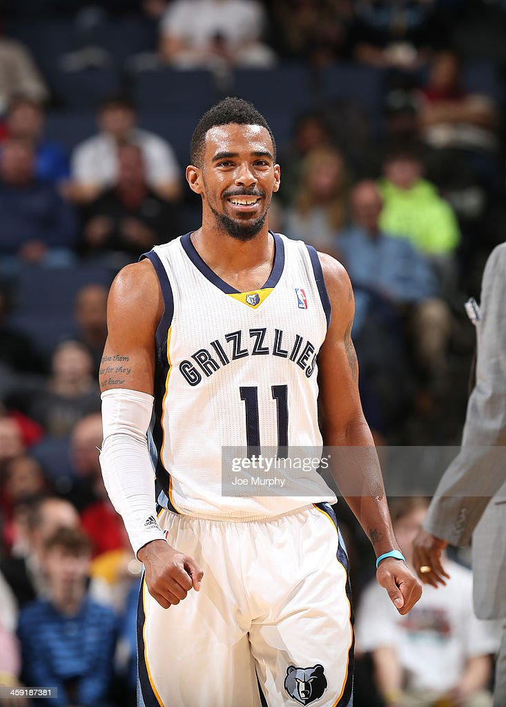 Mike Conley #11 of the Memphis Grizzlies smiles during a game against the Utah Jazz on December 23, 2013 at FedExForum in Memphis, Tennessee.