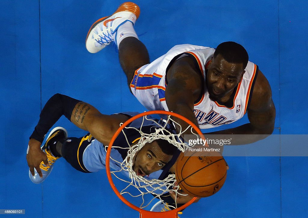 Mike Conley #11 of the Memphis Grizzlies takes a shot against Kendrick Perkins #5 of the Oklahoma City Thunder in Game Seven of the Western Conference Quarterfinals during the 2014 NBA Playoffs at Chesapeake Energy Arena on May 3, 2014 in Oklahoma City, Oklahoma.