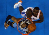 Mike Conley of the Memphis Grizzlies takes a shot against Kendrick Perkins of the Oklahoma City Thunder in Game Seven of the Western Conference...
