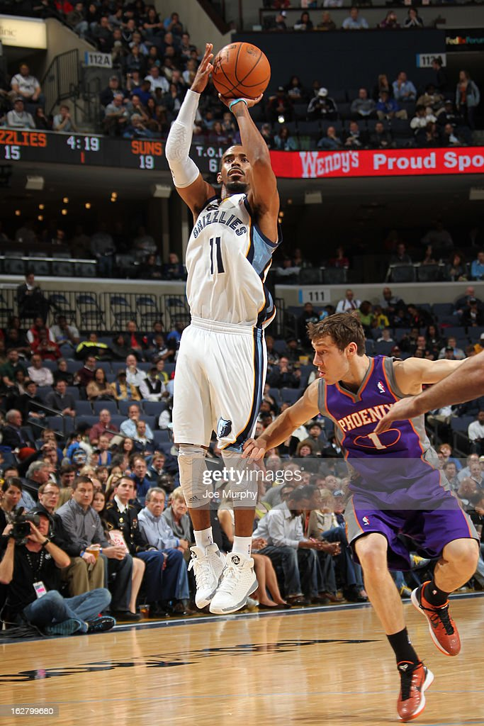 Mike Conley #11 of the Memphis Grizzlies takes a shot against the Phoenix Suns on February 5, 2013 at FedExForum in Memphis, Tennessee.