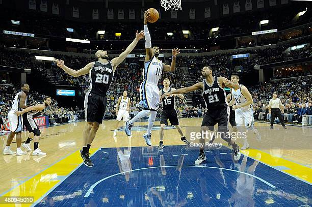 Mike Conley of the Memphis Grizzlies takes a shot during a game against the San Antonio Spurs at the FedExForum on December 30 2014 in Memphis...