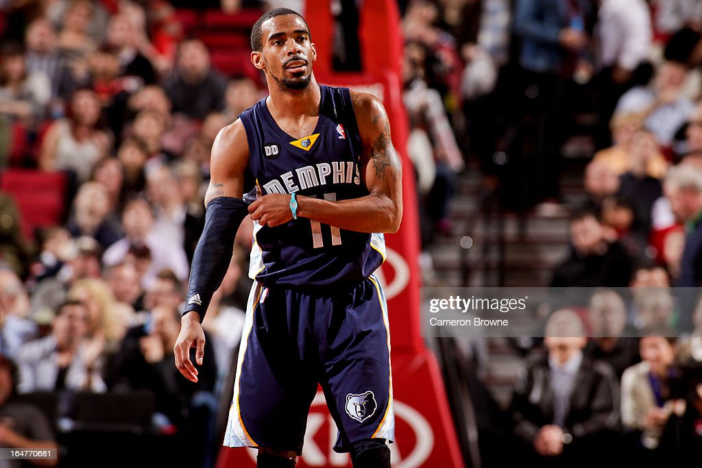 Mike Conley #11 of the Memphis Grizzlies waits to resume game action against the Portland Trail Blazers on March 12, 2013 at the Rose Garden Arena in Portland, Oregon.