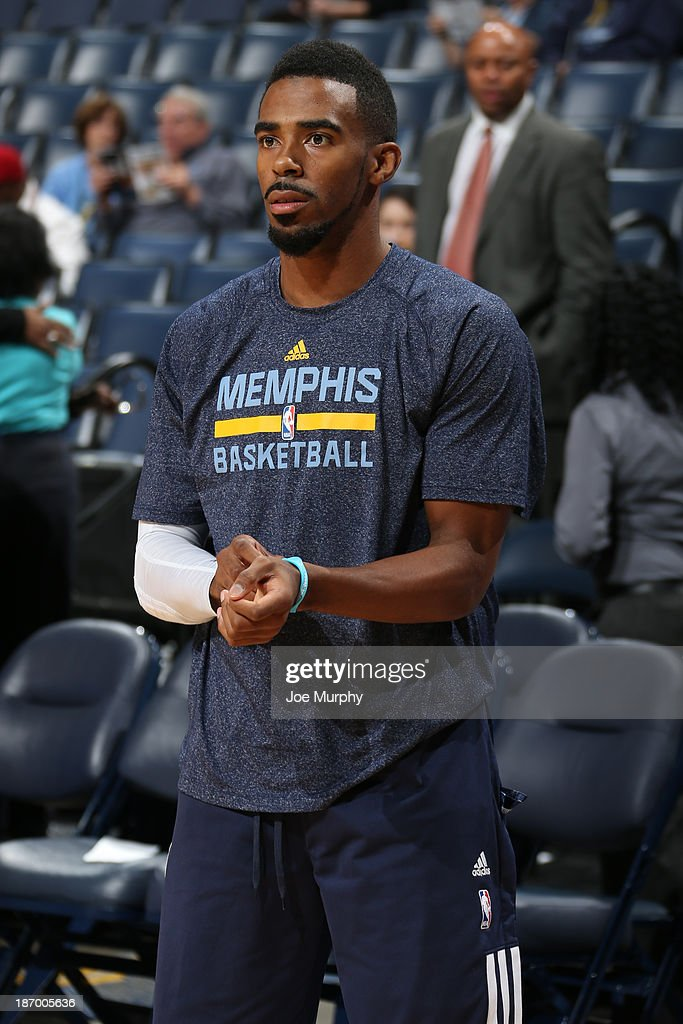 Mike Conley #11 of the Memphis Grizzlies warms up before the game against the Boston Celtics on November 4, 2013 at FedExForum in Memphis, Tennessee.