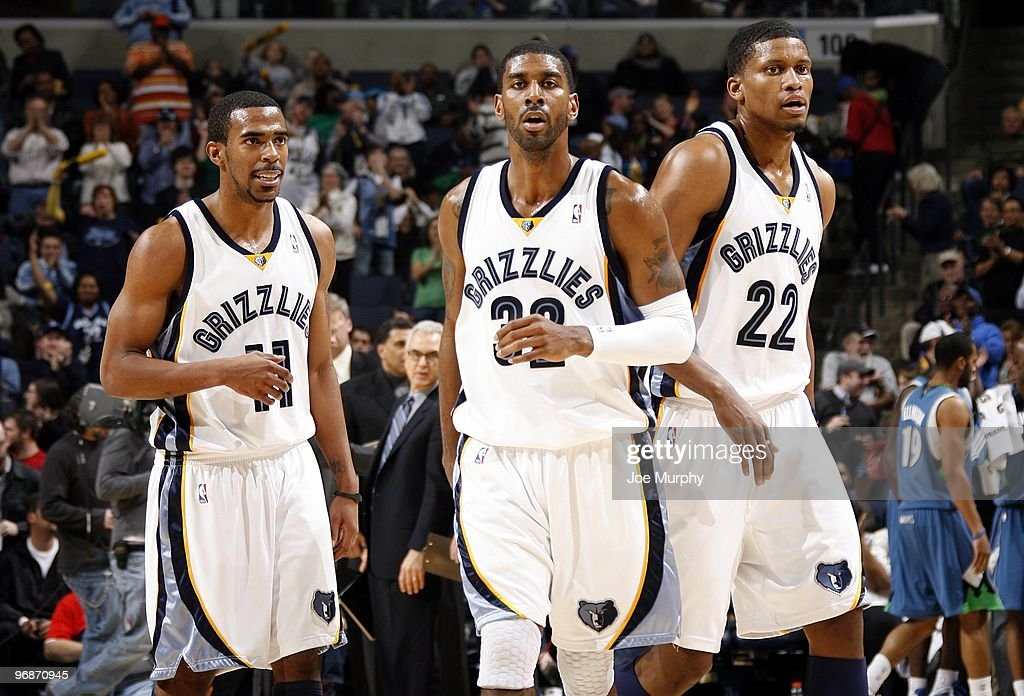 Mike Conley #11, O.J. Mayo #32 and Rudy Gay #22 of the Memphis Grizzlies stand on the court during the game against the Minnesota Timberwolves at the FedExForum on January 15, 2010 in Memphis, Tennessee. The Grizzlies won 135-110.