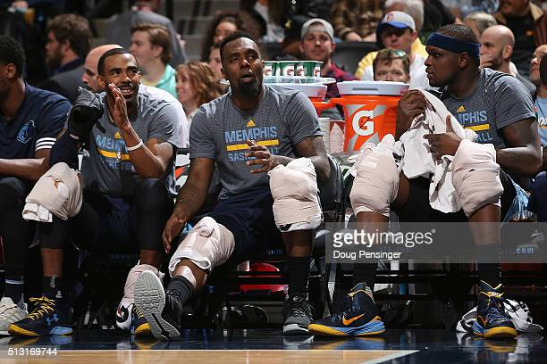 Mike Conley PJ Hairston and Zach Randolph of the Memphis Grizzlies look on from the bench against the Denver Nuggets at Pepsi Center on February 29...
