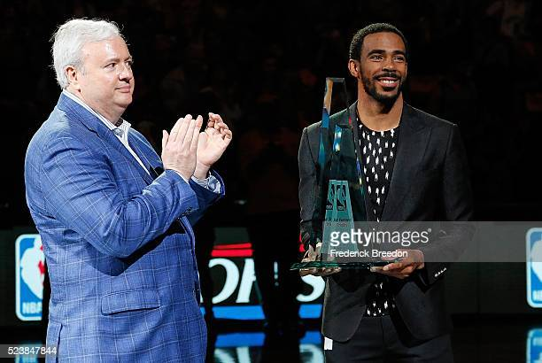 Mike Conley receives the 2016 Joe Dumars NBA Sportsmanship Award from Grizzlies General Manager Chris Wallace prior to Game Four of the First Round...