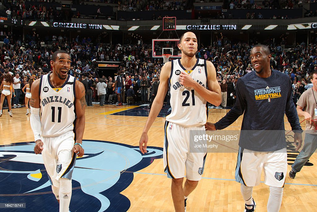 Mike Conley #11, Tayshaun Prince #21, and Tony Wroten #1 of the Memphis Grizzlies celebrate after defeating the Oklahoma City Thunder on March 20, 2013 at FedExForum in Memphis, Tennessee.
