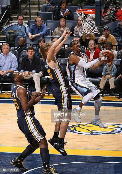 Mike Conley the Memphis Grizzlies shoots a layup against Andrei Kirilenko of the Utah Jazz on January 7 2011 at FedExForum in Memphis Tennessee NOTE...
