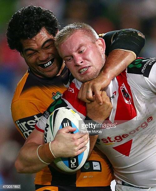 Mike Cooper of the Dragons is tackled by Adam Blair of the Broncos during the round seven NRL match between the St George Illawarra Dragons and the...