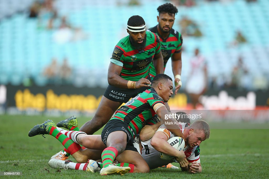 Mike Cooper of the Dragons is tackled during the NRL Charity Shield match between the St George Illawarra Dragons and the South Sydney Rabbitohs at ANZ Stadium on February 13, 2016 in Sydney, Australia.