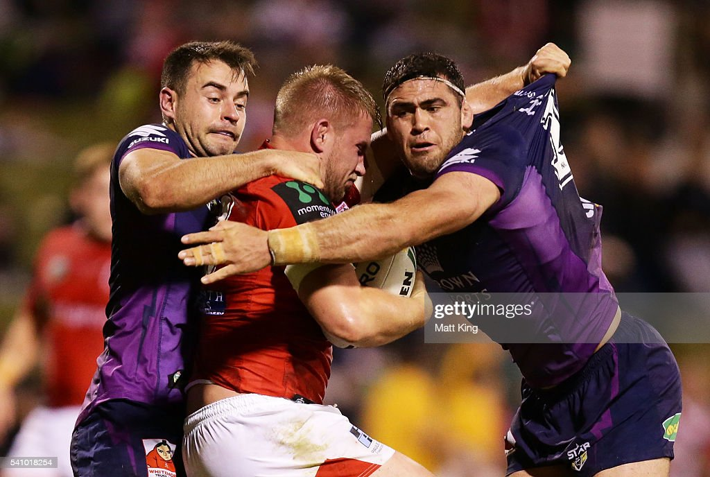 Mike Cooper of the Dragons is tackled during the round 15 NRL match between the St George Illawarra Dragons and the Melbourne Storm at WIN Stadium on June 18, 2016 in Wollongong, Australia.