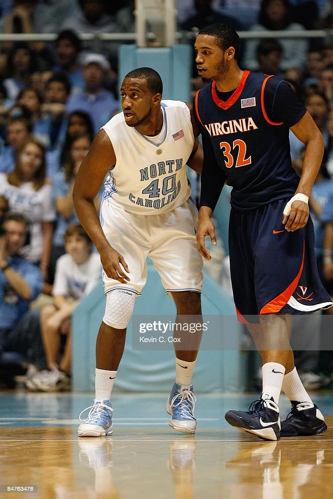 Mike Copeland of the North Carolina Tar Heels guards Mike Scott of the Virginia Cavaliers on February 7 2009 at the Dean E Smith Center in Chapel...