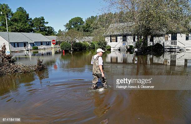 Mike Corey dons wadders as he goes to check on his units as the flood waters rise at the Wyndham Circle duplex complex on Wednesday Oct 12 2016 in...