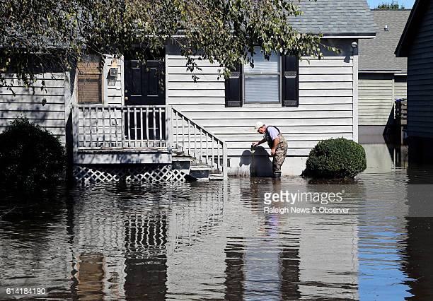 Mike Corey measures the water level as he checks on one of his units as the flood waters creep up on Wednesday Oct 12 2016 at the Wyndham Circle...