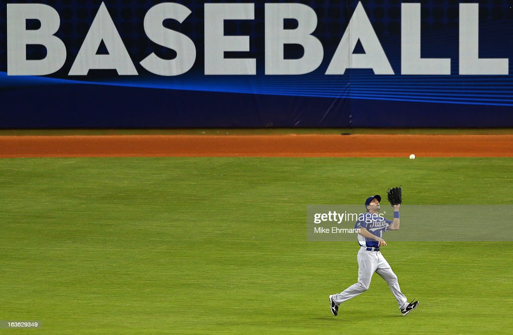 Mike Costanzo #4 of Italy makes a catch during a World Baseball Classic second round game against Puerto Rico at Marlins Park on March 13, 2013 in Miami, Florida.