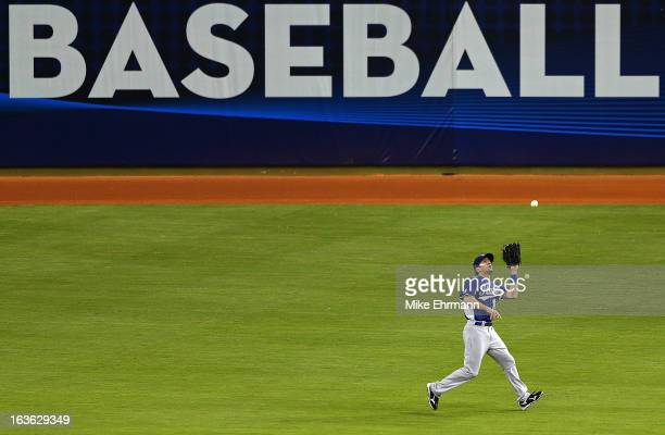 Mike Costanzo of Italy makes a catch during a World Baseball Classic second round game against Puerto Rico at Marlins Park on March 13 2013 in Miami...