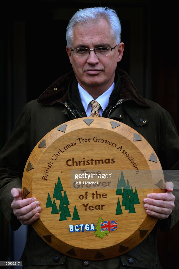 Mike Craig Director of Garrocher Tree Farm holds his award on November 10, 2012 in Creetown, Scotland. The tree grower, won the coveted title of Champion Christmas Tree Grower 2012 at the 14th Annual British Christmas Tree Growers' Association and will now deliver a sixteen foot six inch tree to take up residence outside 10 Downing Street.