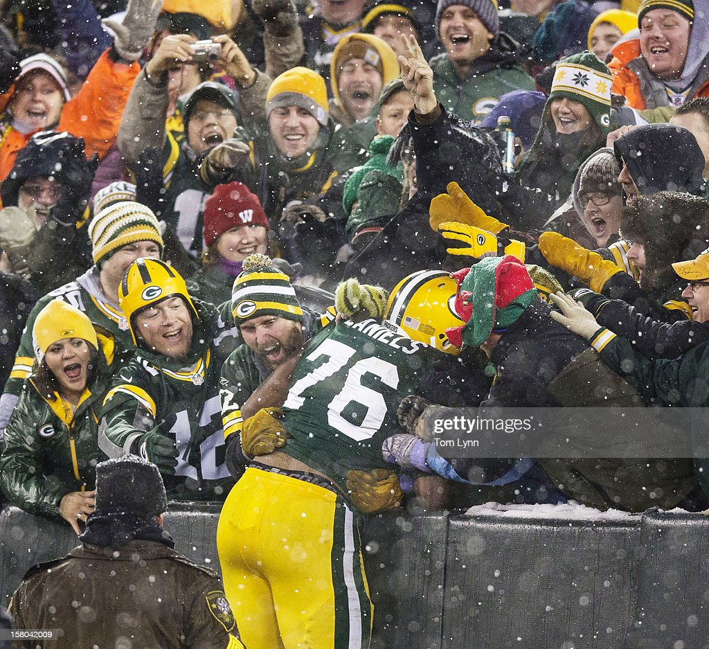 Mike Daniels #76 of the Green Bay Packers does a Lambeau after he scored a touchdown on a fumble recovery at Lambeau Field on December 9, 2012 in Green Bay, Wisconsin.