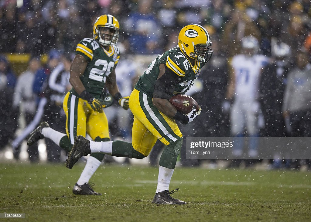 Mike Daniels #76 of the Green Bay Packers picks up a Detroit Lion fumble and runs it back for a touchdown at Lambeau Field on December 9, 2012 in Green Bay, Wisconsin.
