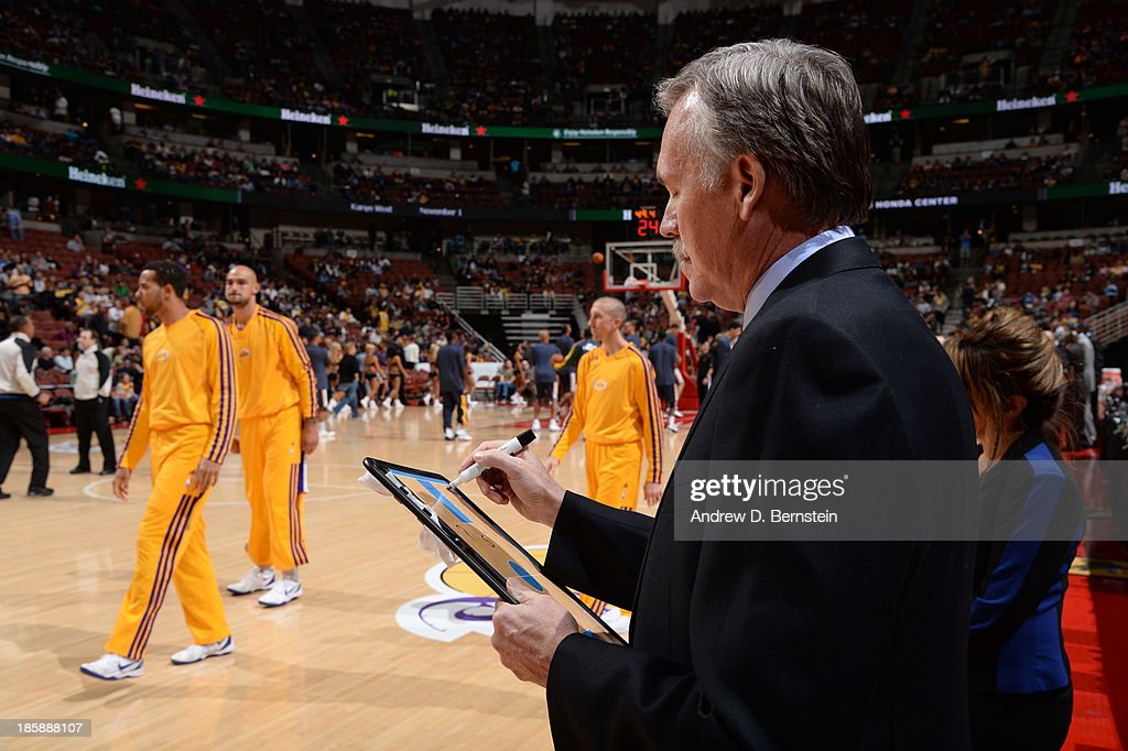 <a gi-track='captionPersonalityLinkClicked' href=/galleries/search?phrase=Mike+D%27Antoni&family=editorial&specificpeople=203175 ng-click='$event.stopPropagation()'>Mike D'Antoni</a>, Head Coach of the Los Angeles Lakers draws out a play during a preseason game against the Utah Jazz at the Honda Center in Anaheim, California on October 25, 2013.